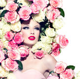 Sexy girl with pink and white roses hairstyle. Sexy model girl with pink and white roses hairstyle Royalty Free Stock Photos