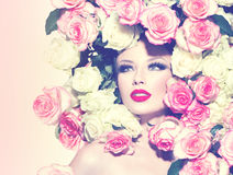 Sexy girl with pink and white roses hairstyle Royalty Free Stock Photos