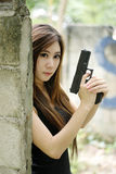 girl with pistol Stock Photography