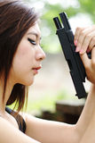 Sexy girl with pistol. Thai sexy girl holding the pistol Stock Photo
