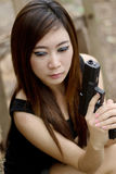 Sexy girl with pistol. Thai sexy girl holding the pistol Stock Photography
