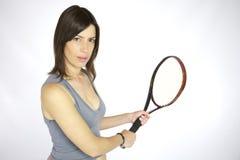 Sexy girl playing tennis Royalty Free Stock Photos