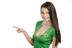 Sexy girl pointing in front. Royalty Free Stock Images