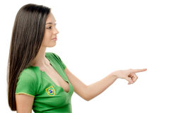 Sexy girl pointing in front. Stock Photo
