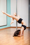 Sexy girl pole dancing in style Stock Photo