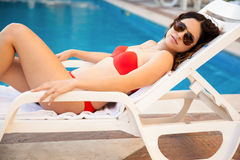 Sexy girl in a poolside Stock Photos