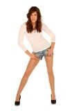 Girl posing. Brunette girl posing in jeans shorts stock image
