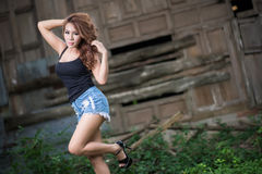 Sexy girl is posing against wood background Stock Images