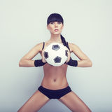Sexy girl posing with ball Stock Photo