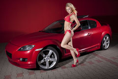 Sexy girl posing close to the sports car. Stock Photo