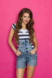 Sexy Girl Posing In Dungarees Stock Images