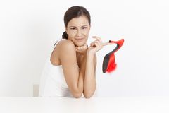 girl posing with high heel slippers smiling Royalty Free Stock Photo