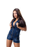 Sexy girl posing in jeans costume isolated Royalty Free Stock Photography