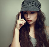 Sexy girl posing in modern grey cap. Vintage Stock Photography