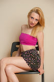 Sexy Girl Posing. Pretty sexy girl with blond hair posing in pink top and short skirt Stock Photography