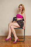 Sexy Girl Posing. Pretty sexy girl with blond hair posing in pink top and short skirt Royalty Free Stock Photography