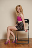 Sexy Girl Posing. Pretty sexy girl with blond hair posing in pink top and short skirt Royalty Free Stock Images