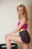 Sexy Girl Posing. Pretty sexy girl with blond hair posing in pink top and short skirt Stock Photos