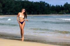 Sexy girl posing at tropical beach Stock Photos