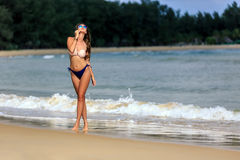 Sexy girl posing at tropical beach Royalty Free Stock Photos