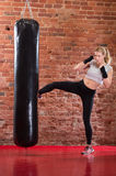 Sexy girl practicing kick boxing Stock Images