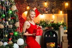 Sexy girl red dress celebrate merry christmas. Christmas celebration concept. Corporate party. Favorite season of year. Happiness and joy. Girl celebrate new royalty free stock photography
