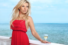 Sexy girl in red dress by the sea Stock Photos
