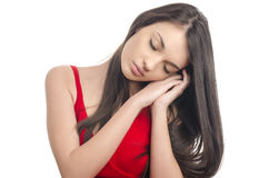Sexy girl in red dress sleeping. Stock Photos