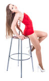 Sexy girl in red dress with stool Stock Photography
