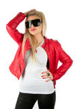 Sexy girl in red leather jacket posing in studio Royalty Free Stock Image