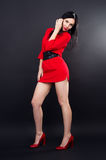 Sexy girl in red mini dress posing Stock Photography