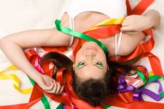 Sexy girl with red ribbons Royalty Free Stock Images