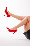Sexy girl in red shoes. Royalty Free Stock Image