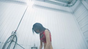 Sexy girl in a red suit taking shower stock footage