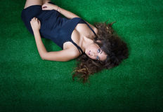 Sexy girl relax in a park and looks up Royalty Free Stock Photos