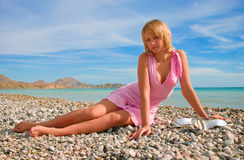 Sexy girl relaxing on a beach Stock Images
