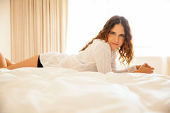 Sexy girl relaxing in a bed Stock Images