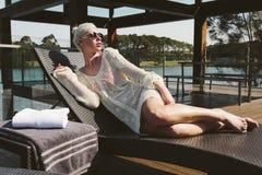 Girl on sunbed Stock Photos