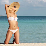 Sexy Girl relaxing on the Tropical Beach. Glamour Blonde woman Royalty Free Stock Photography