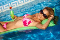 Sexy girl relaxing on water at summertime Royalty Free Stock Photos