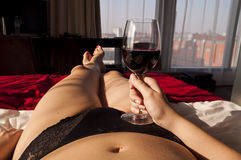 Sexy girl relaxing with wine - point of view photo Royalty Free Stock Images
