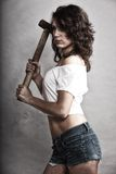 Sexy girl repairman holding hammer tool Stock Photo