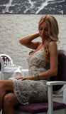 Sexy girl in restaurant. Blonde sitting and posing in restaurant Royalty Free Stock Photography