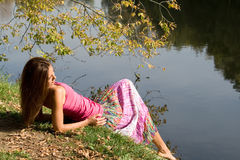 girl resting near pond Royalty Free Stock Photography