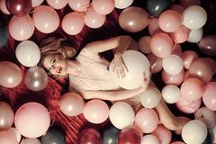 Sexy girl with retro makeup and blond hair. Retro woman with party balloons, celebration. Beauty and fashion, cosmetics, vintage. Pin up woman in balloons Stock Photos