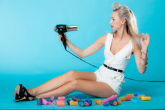 Sexy girl retro style in curlers with hairdryer st Stock Photo