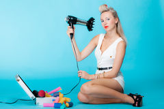 Sexy girl retro style in curlers with hairdryer styling hair Stock Images