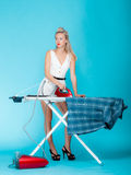 Sexy girl retro style ironing male shirt, woman housewife in domestic role. Full length sexy girl retro style ironing male shirt, woman housewife in domestic Stock Image