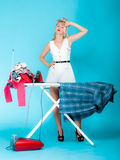 girl retro style ironing male shirt, woman housewife in domestic role. royalty free stock images