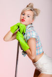 Sexy girl retro style, woman housewife cleaner with mop Stock Photo